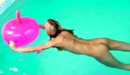 Hot blonde in the pool and she is having fun with a huge pink sex toy