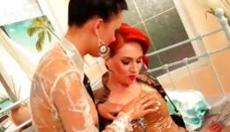 Hot brunette and a redhead are pleasuring their oiled wet holes