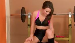 Seductive bitch in the gym is training her tight young vagina hole with the dildo