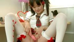 Young asian beauty is solo playing with a long pink dildo in dirty way