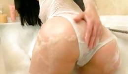 Skinny brunette is taking a hot shower and is masturbating her pussy